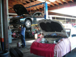 car on rack, auto repair, covina, glendora, san dimas
